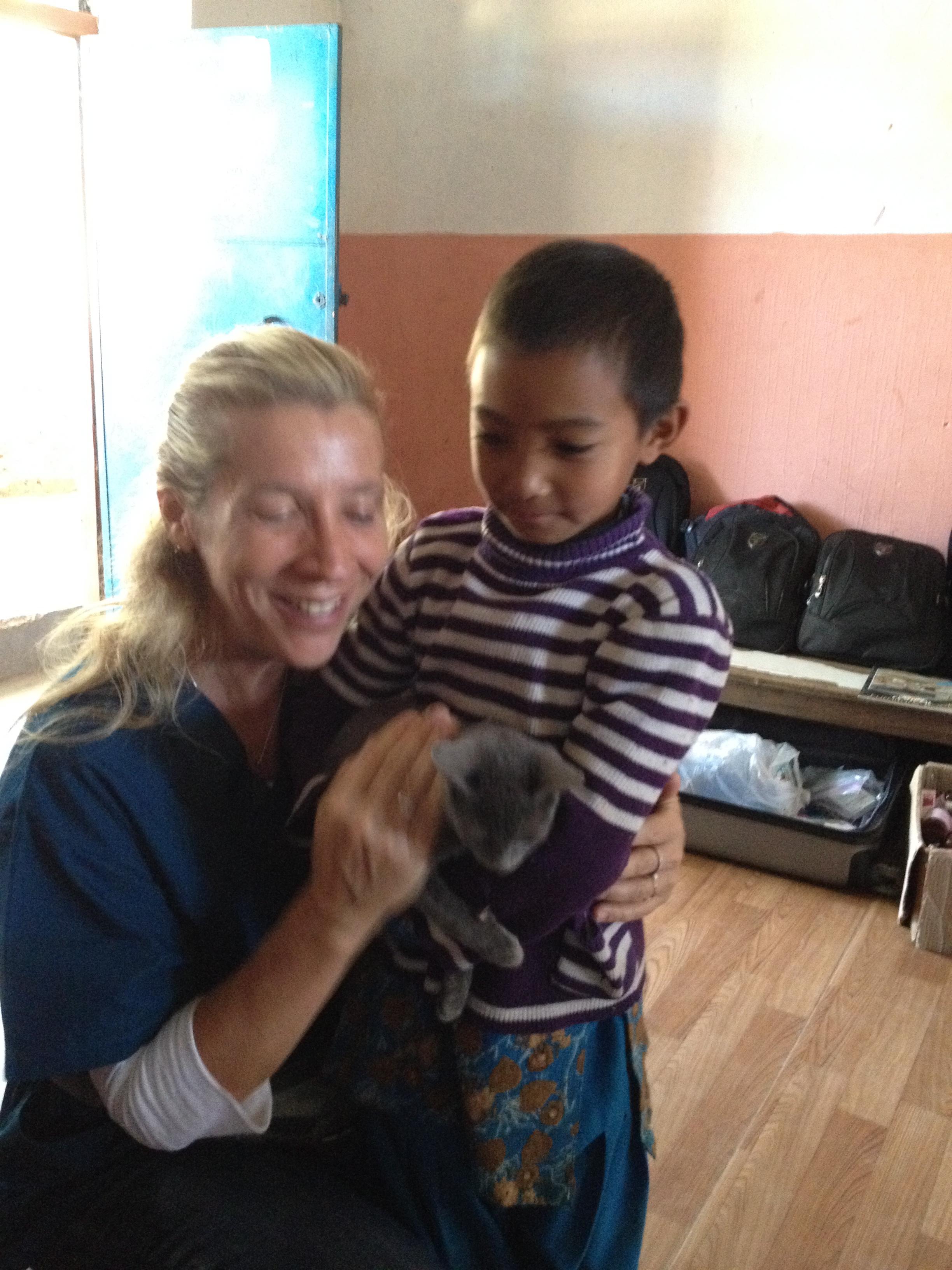 C & Dadagaun child hug kitten.jpg