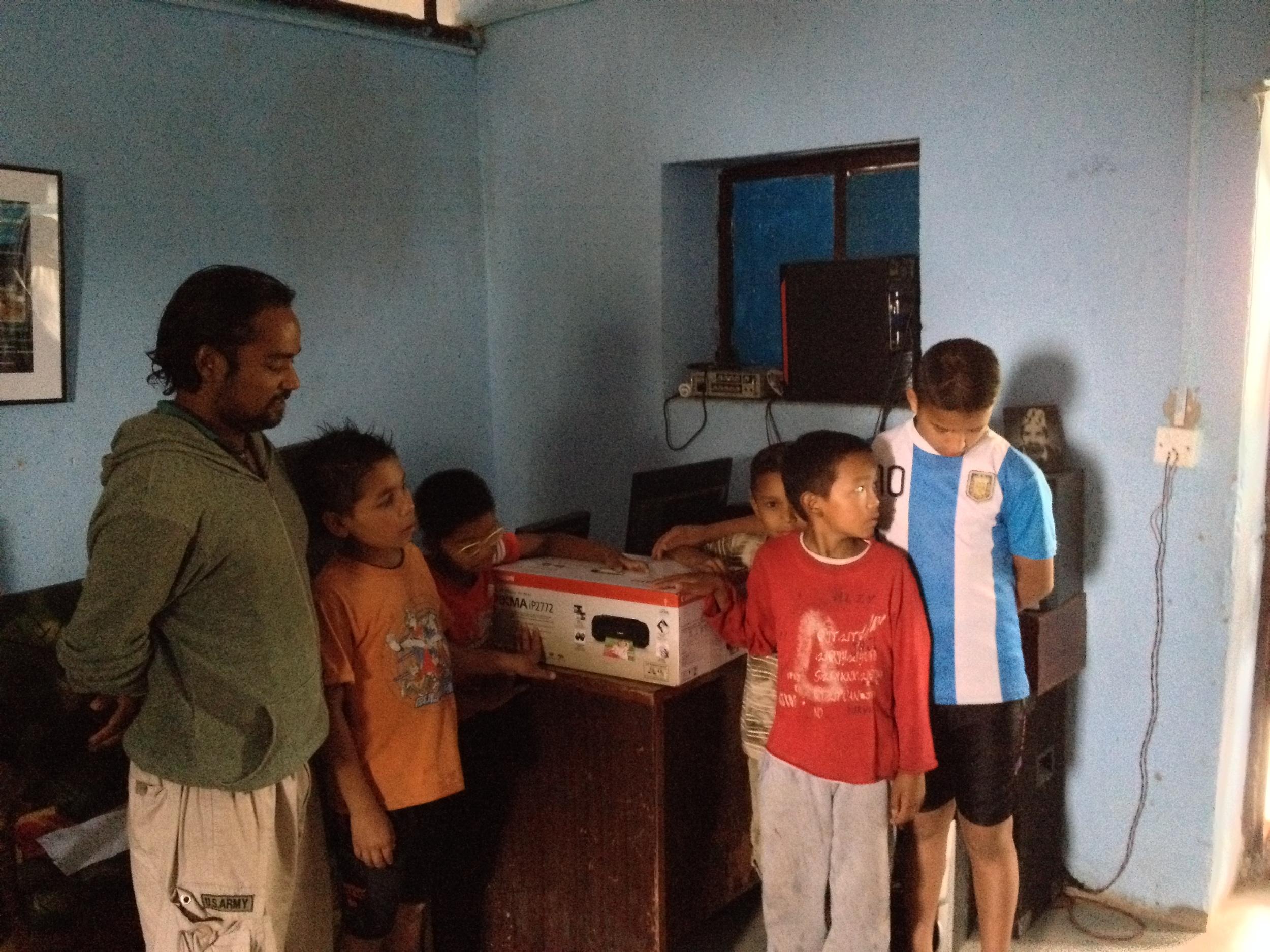 Anatta donates a color printer.JPG
