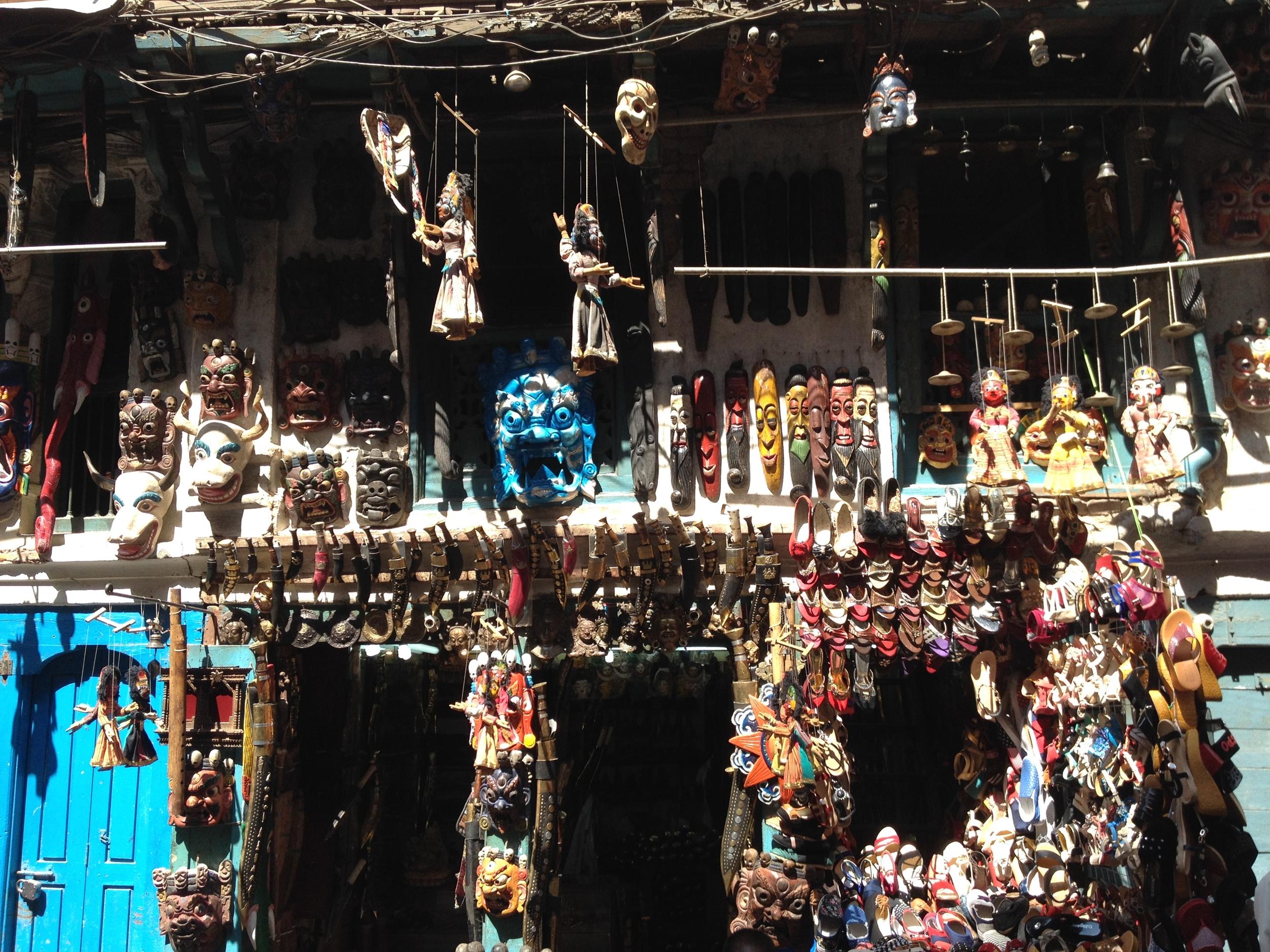 masks in Kathmandu storefront.JPG
