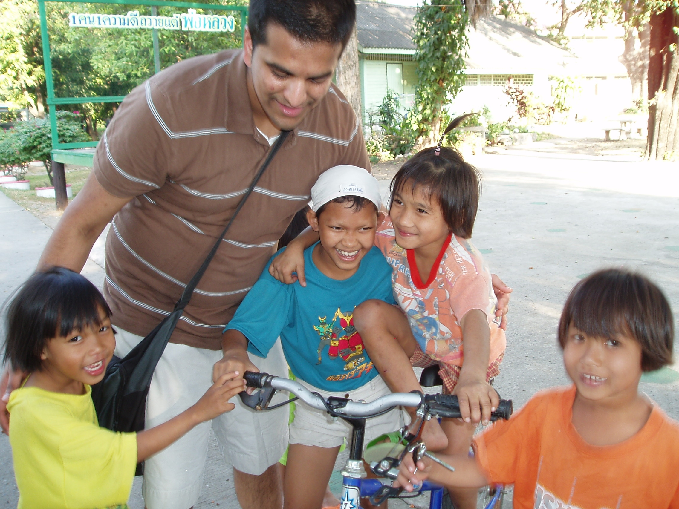 Neil & Saraburi on bike.JPG