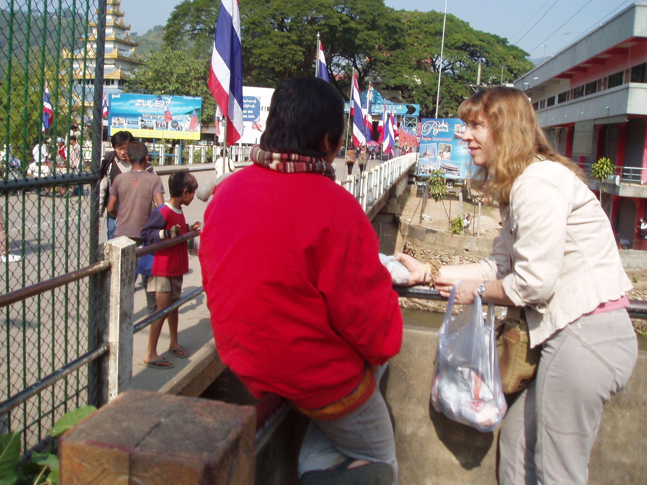 Feeding Orphans at Bridge.JPG
