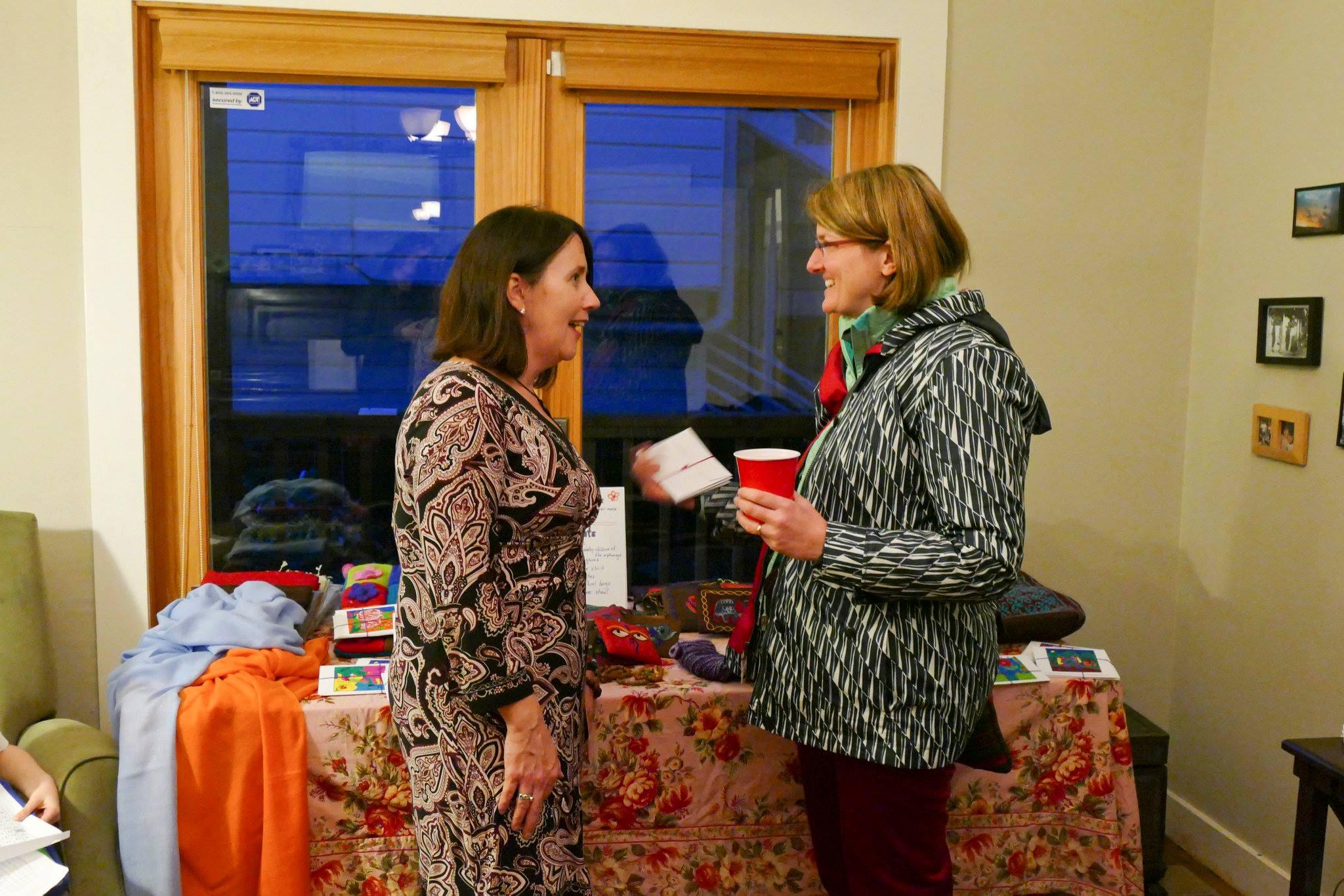 Eileen greeting guests 2016.jpg