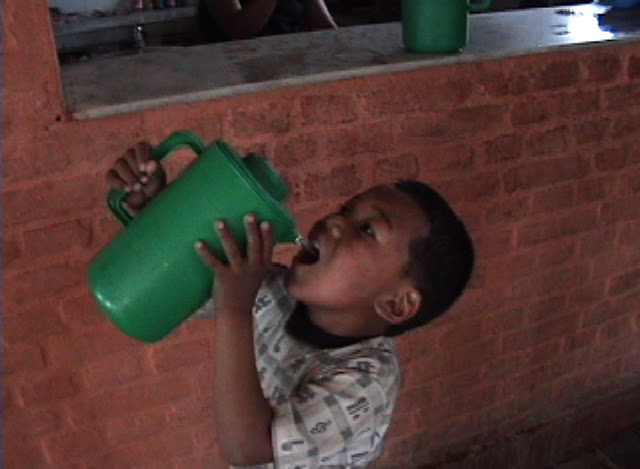 Boy drinking from pitcher.JPEG