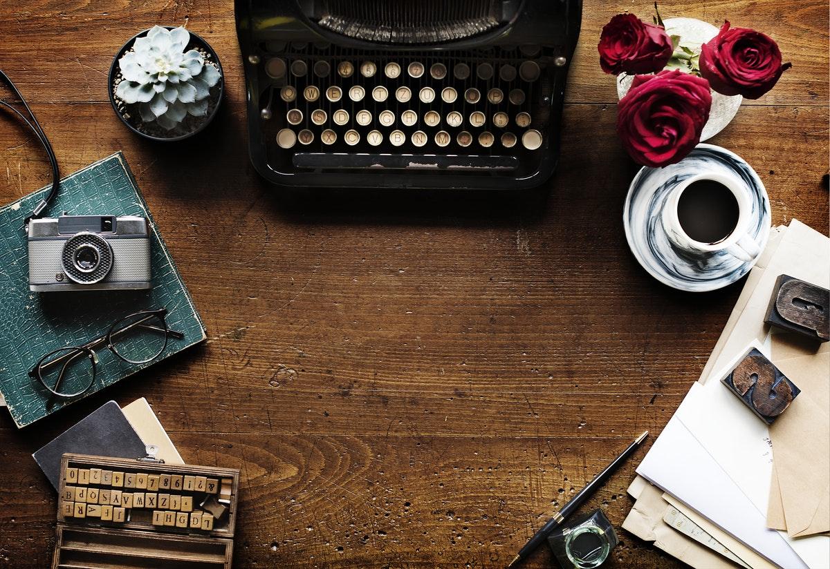 Rawpixel-Retro-Typewriter-Machine-with-Paper-on-Workspace.jpg