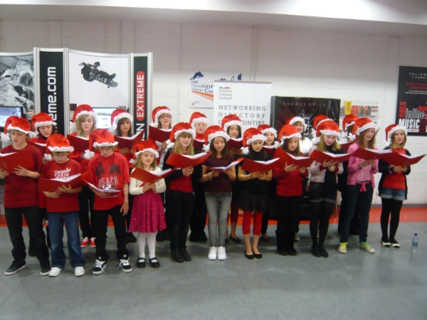 Phoenix Youth Theatre pupils singing Christmas songs