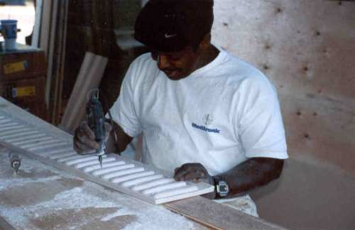 Finishing touches are made on the new reconstructed cove moldings.