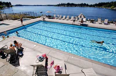 DEAN J. KOEPFLER/THE NEWS TRIBUNE With the average age of its social members topping 75, Tacoma Country & Golf Club in Lakewood decided to build a pool to attract younger members and their families. The $1.4 million pool opened July 4 and has a commanding view of American Lake.