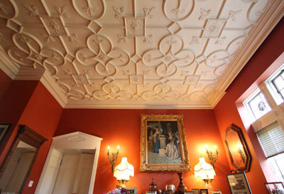 The gentleman's parlor, with moulded ceiling, sits just off the front entrance of the castle. (Photos by Janet Jensen/Staff Photographer)