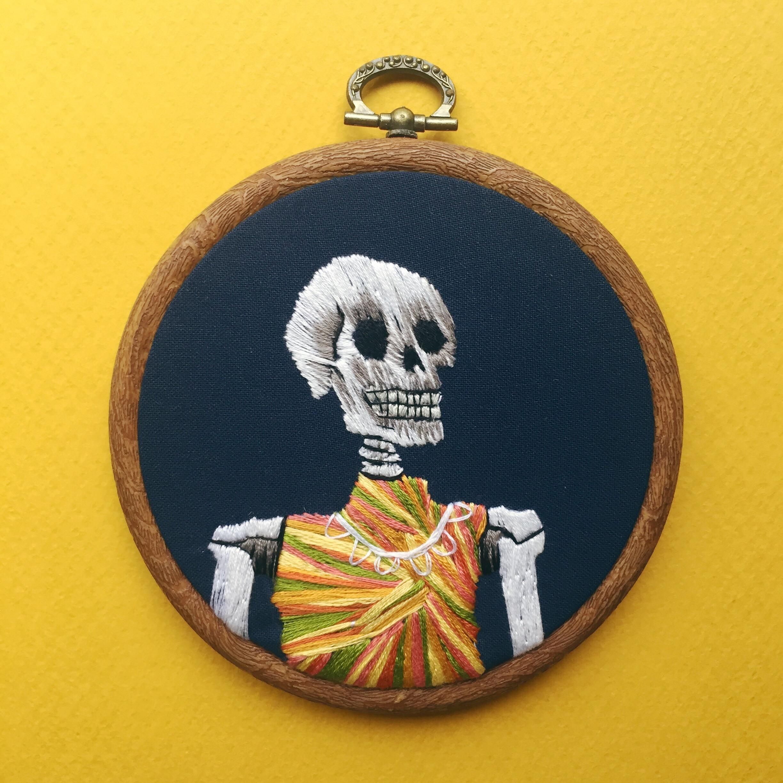 Skeleton in a 70s patterned dress