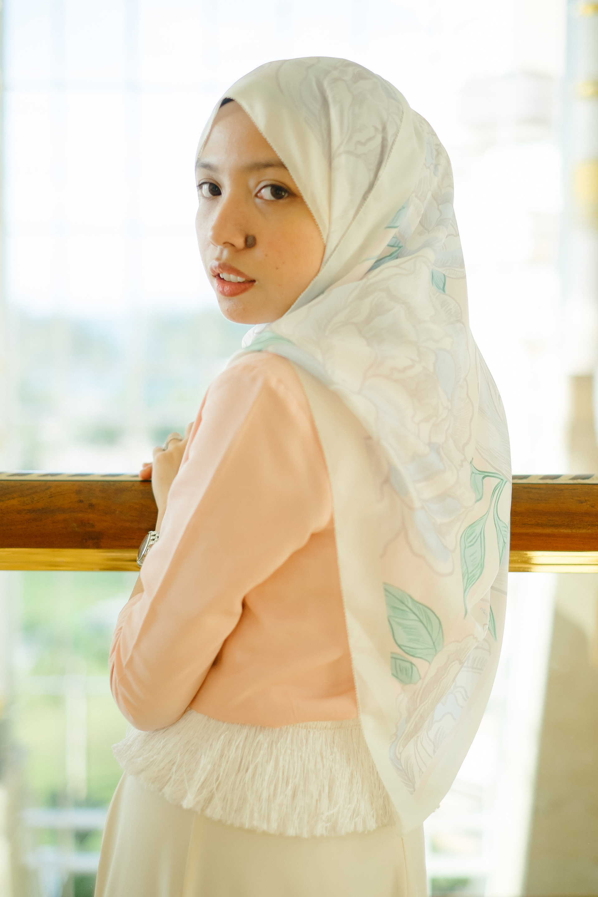 Wearing the most sought after scarf, The Blooming Duck in White. Picture credit to Zahra.