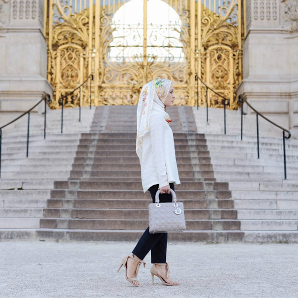 Vivy is breathing the Parisian air while standing in front of the iconic golden gate of Grand Petit Palais.Picture Credit to @thedUCkgroup media