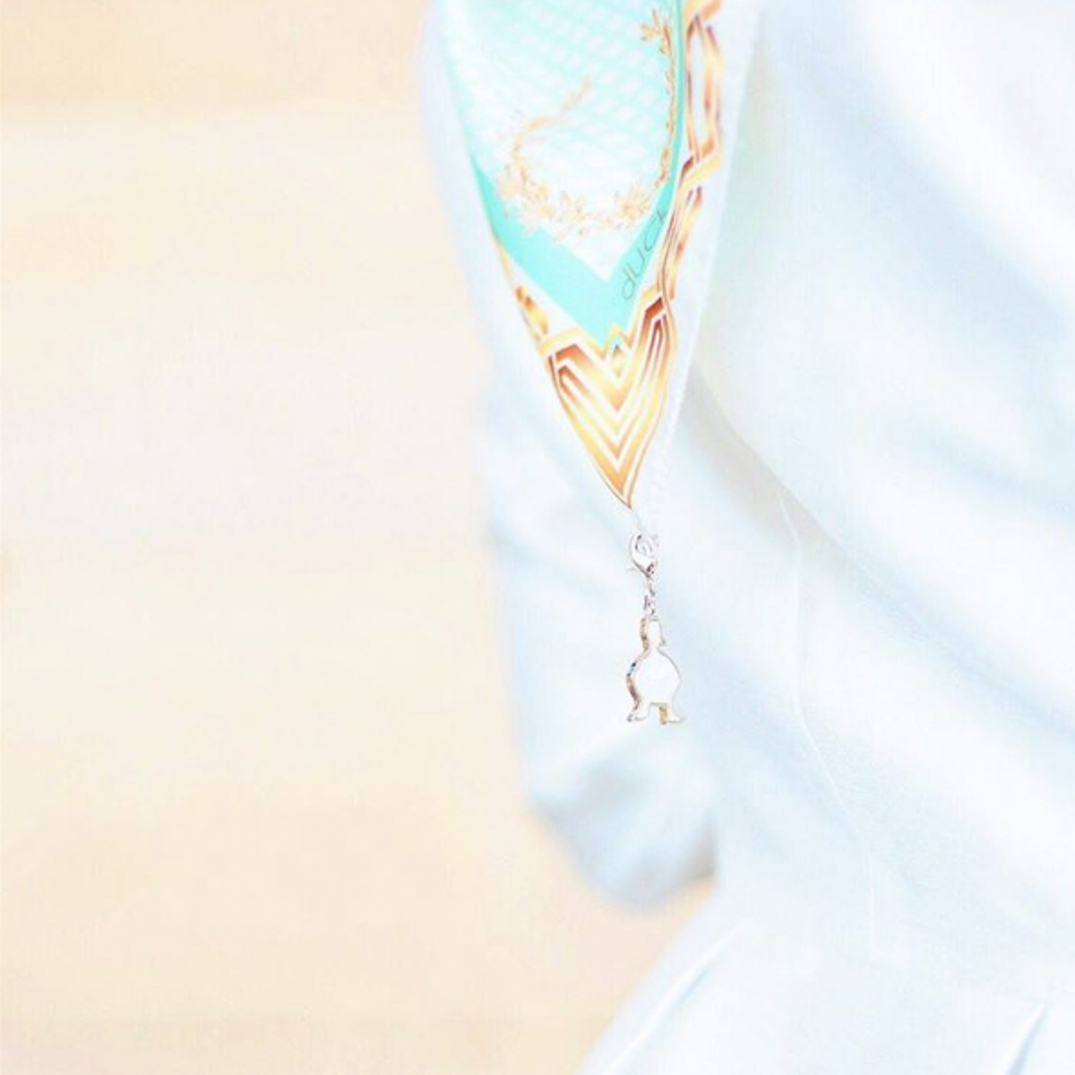 The detail of the hanging dUCk charm, covered in mother of pearl, which symbolises the creation that blends the two brands seamlessly.Picture Credit to @thedUCkgroup media
