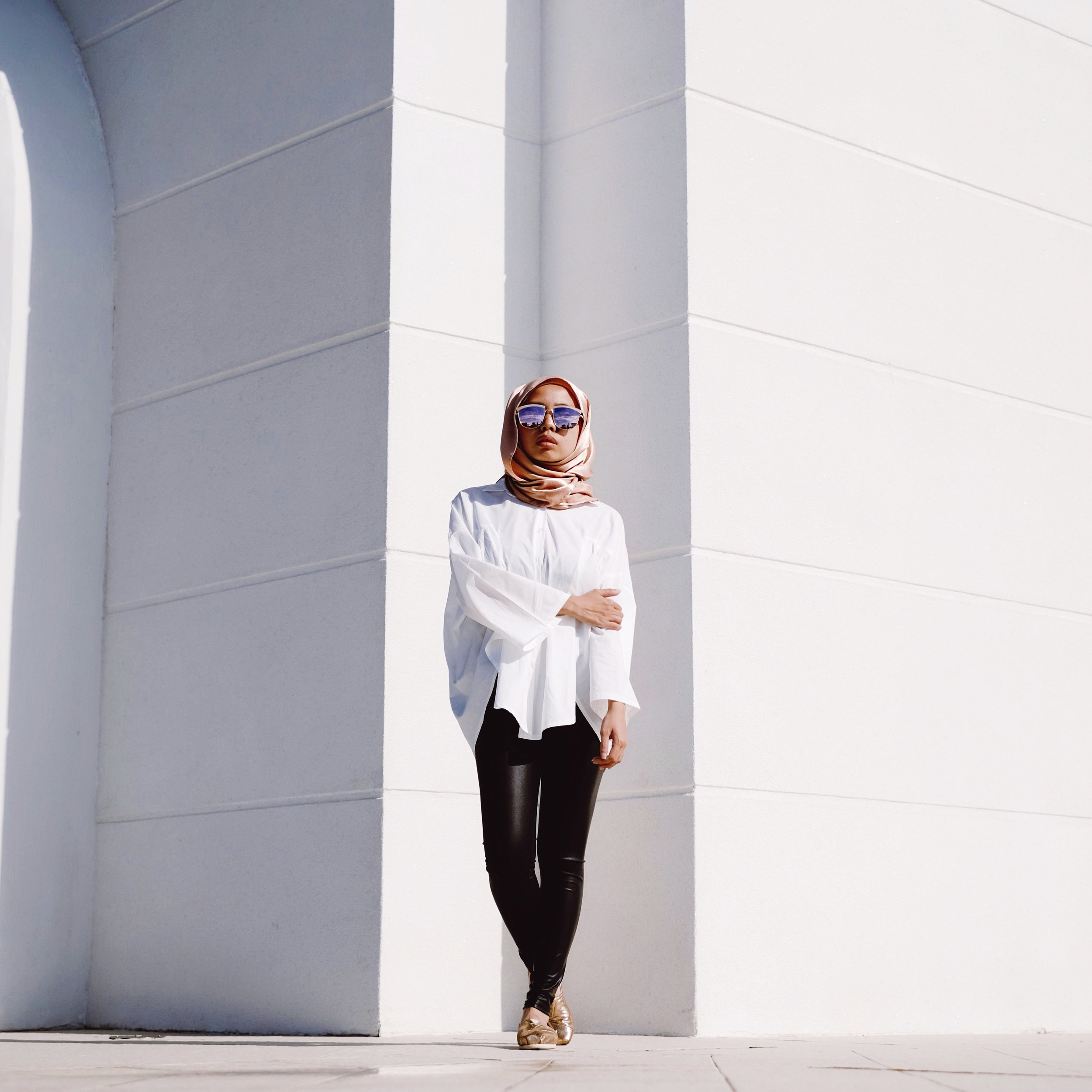 Family weekend - Go easy by opting for an oversized shirt with your leather leggings.