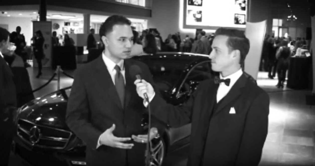 Lloyd Ball getting interviewed by red carpet host Jed Etters at one of his networking events.