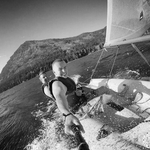 Ray Makela windsurfing with one of his sons in Hawaii.