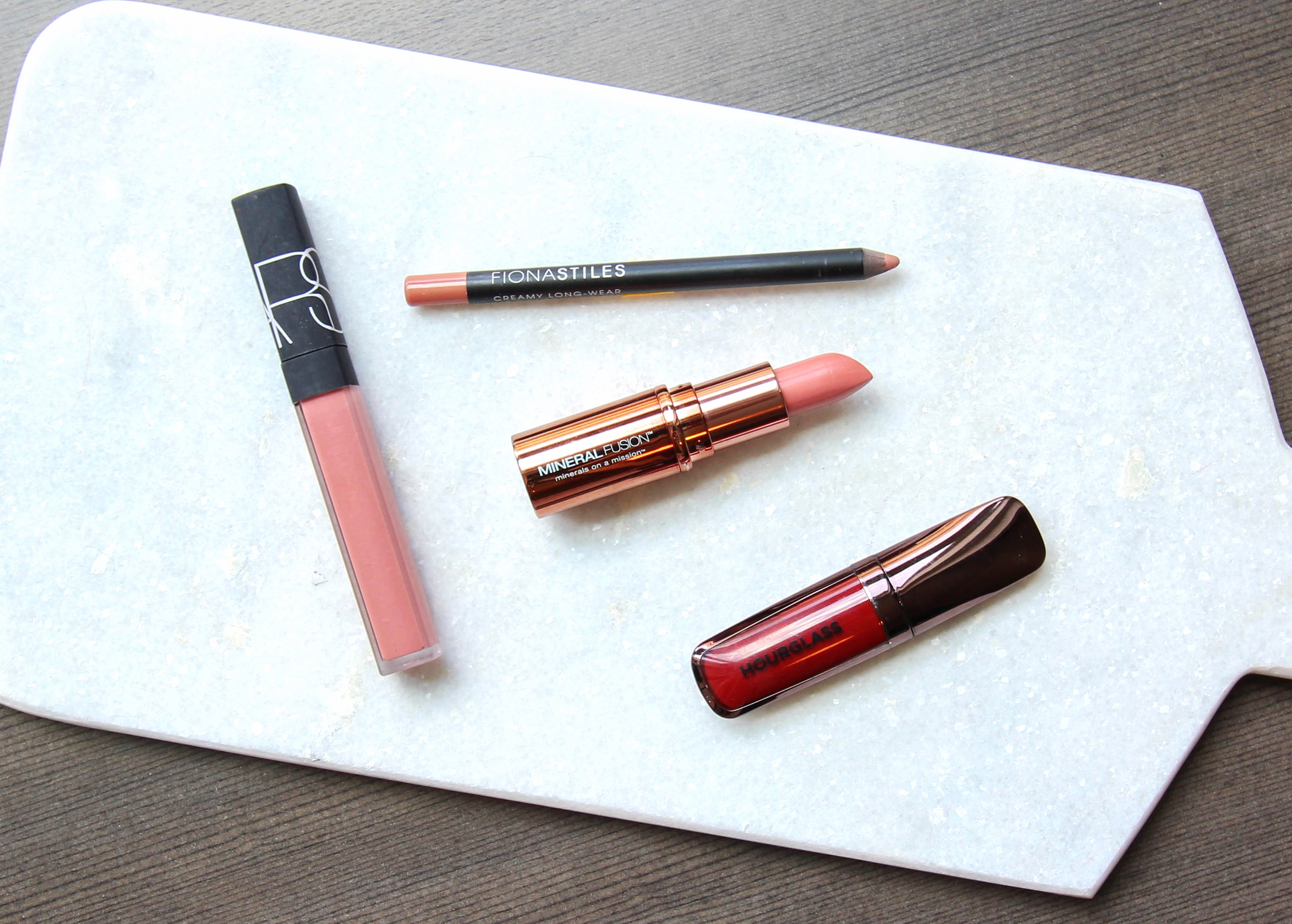 LEFT TO RIGHT: NARS - Chelsea Girls, Fiona Stiles - Doña Amelia, Mineral Fusion - Nude, Hourglass - Icon