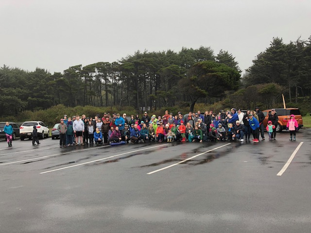Picture of our families before the Fossil Guy presentation. Look at all those rain boots!