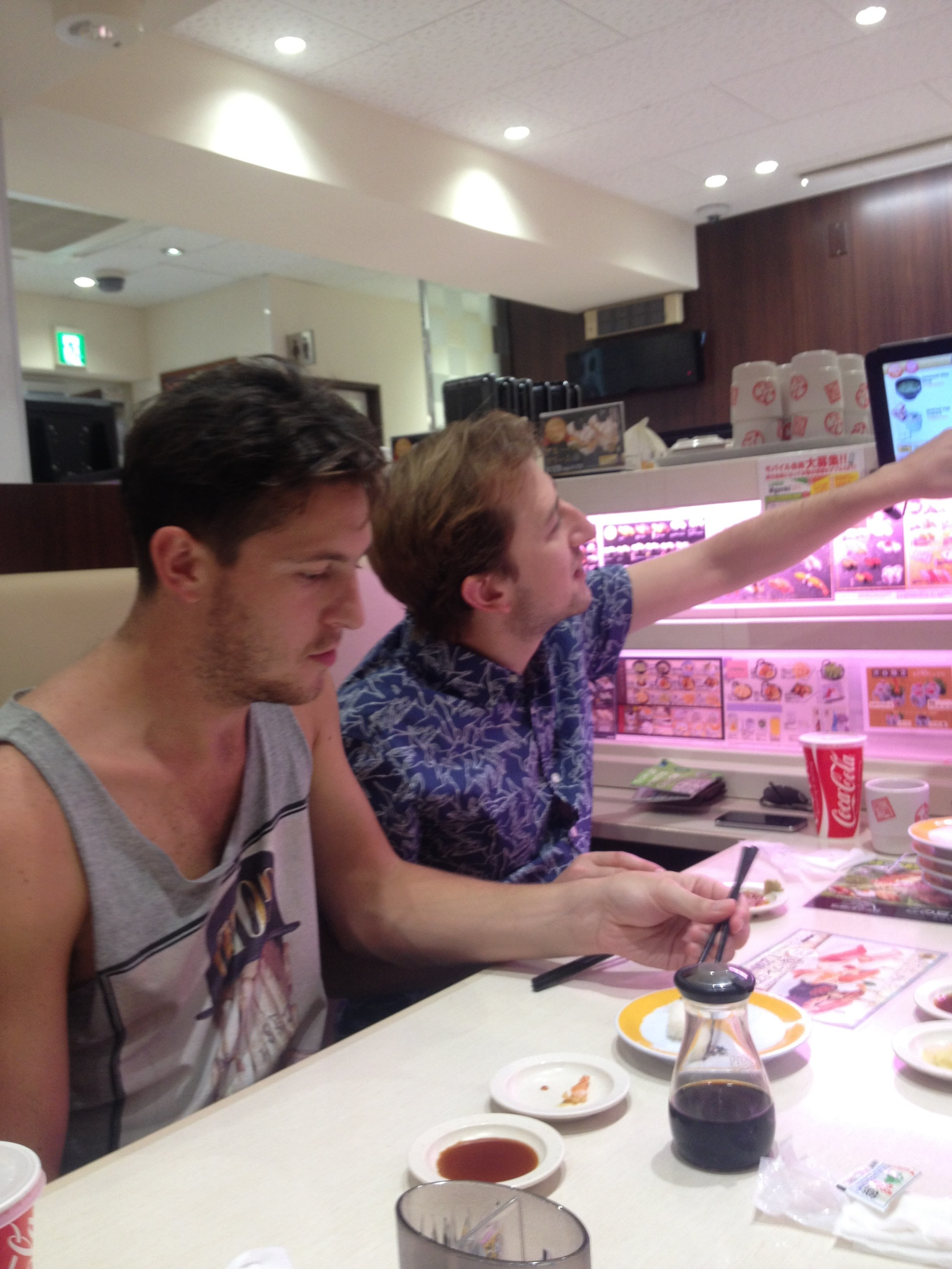 Their first time trying sushi train!