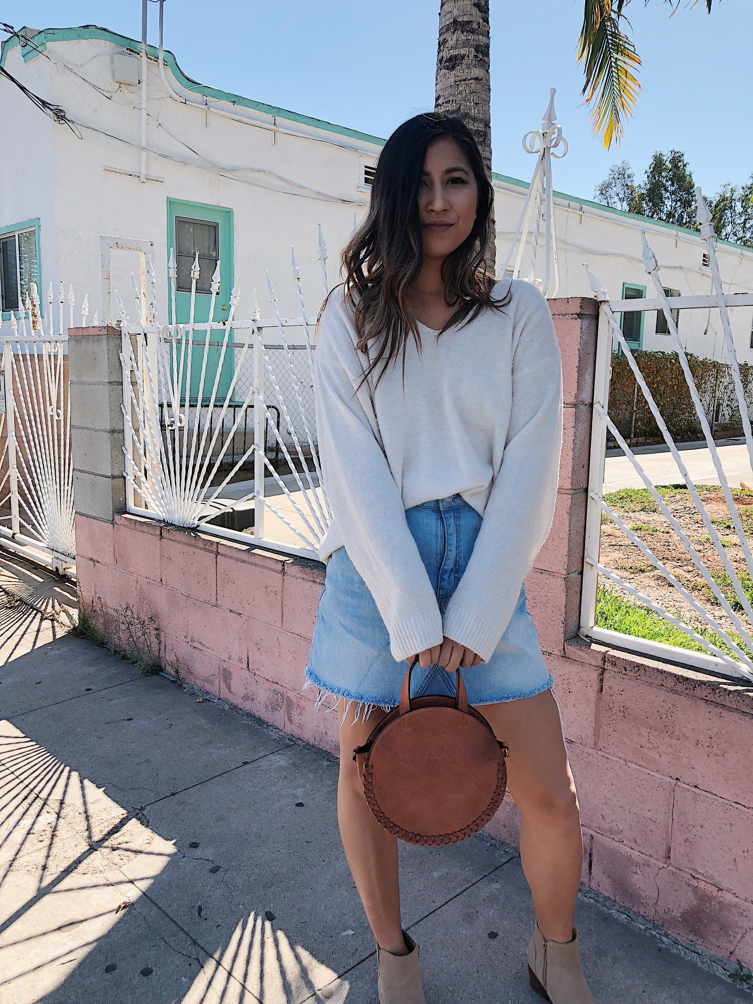 H&M oversized sweater, Urban Outfitters denim skirt Free People brown leather handbag, Aldo beige low-heel boots  Photography by Reginald Guinto