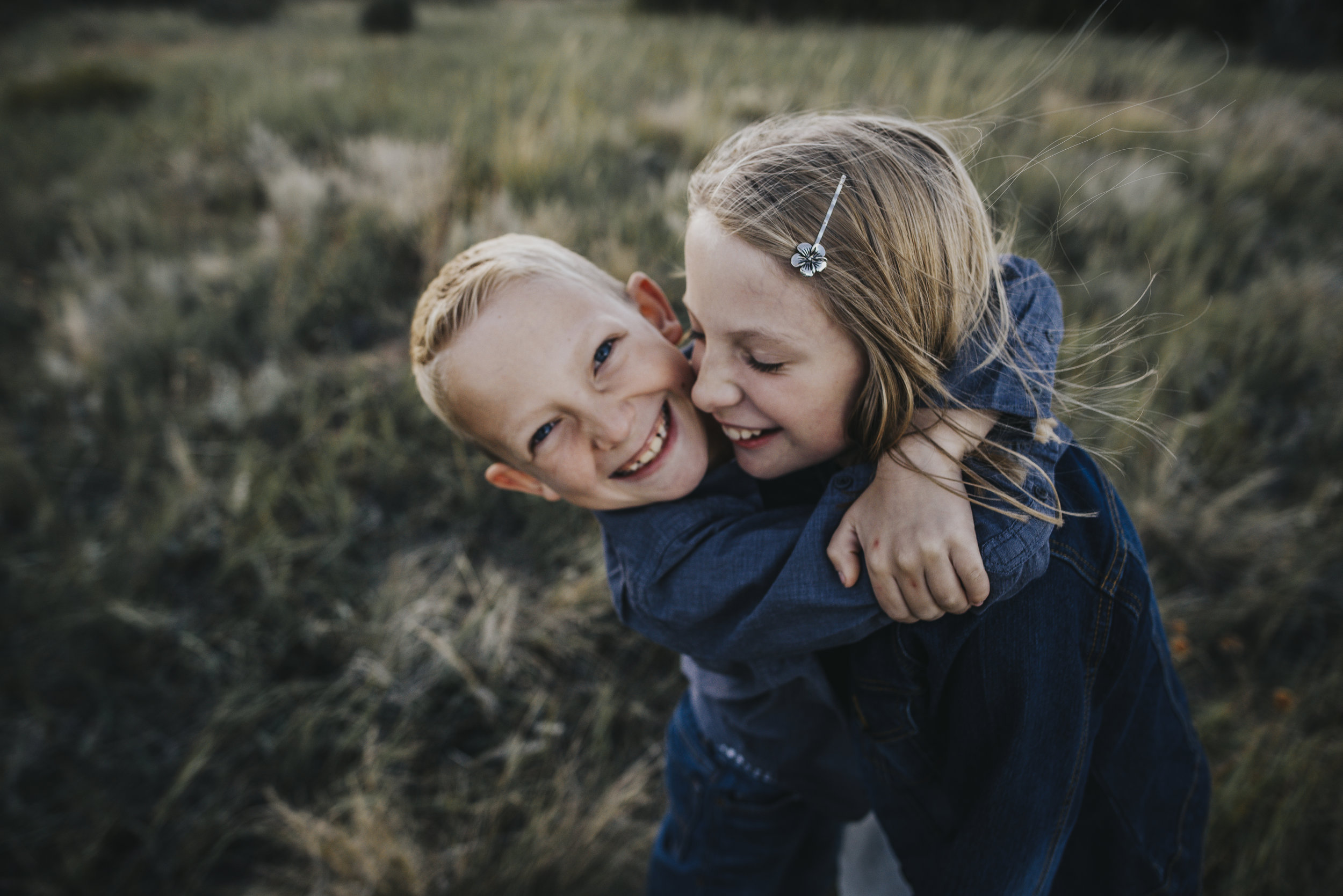 Brother and sister hug each other in a Colorado Springs mountain session.