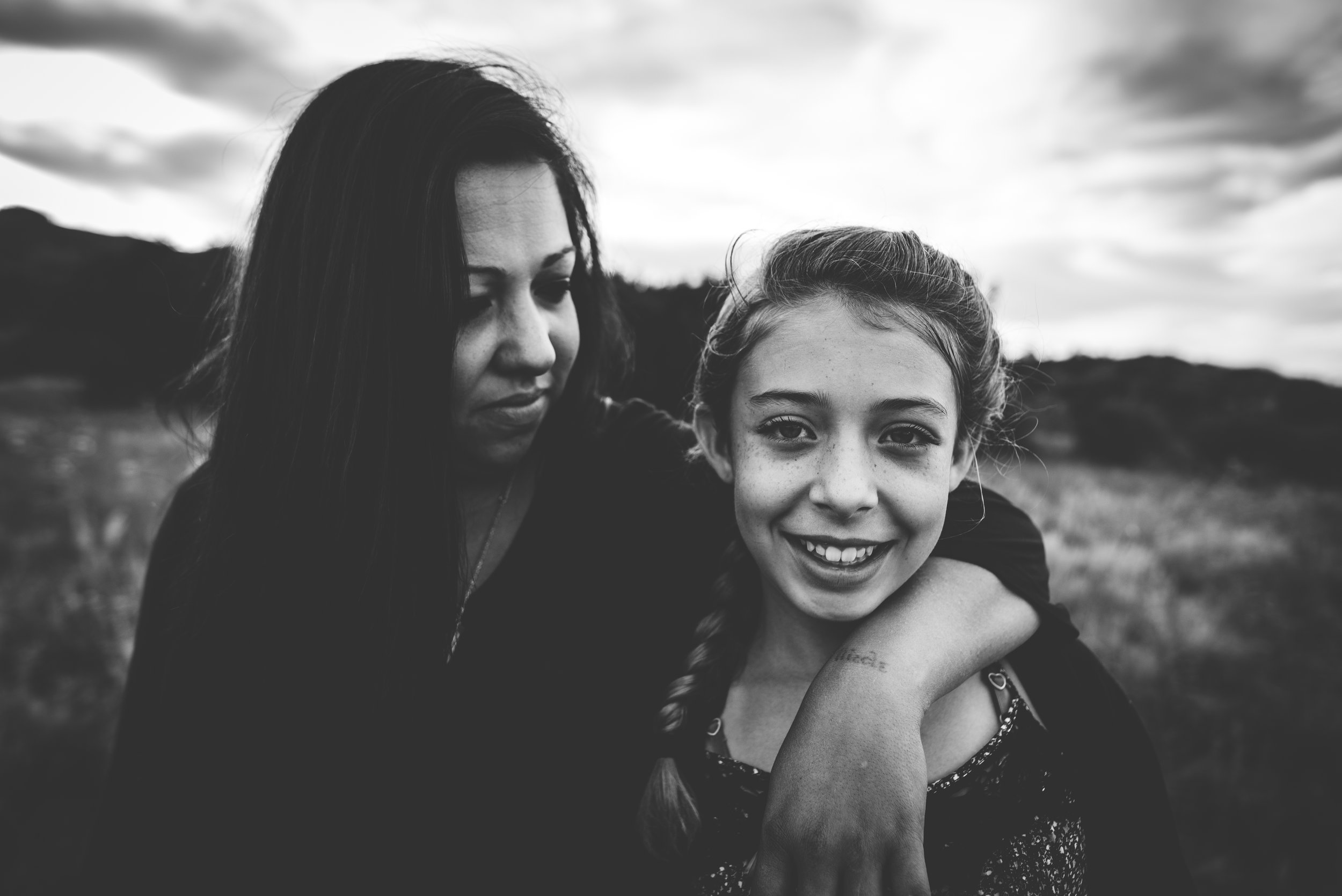 Mother and daughter embrace during family session in Colorado Springs mountains.