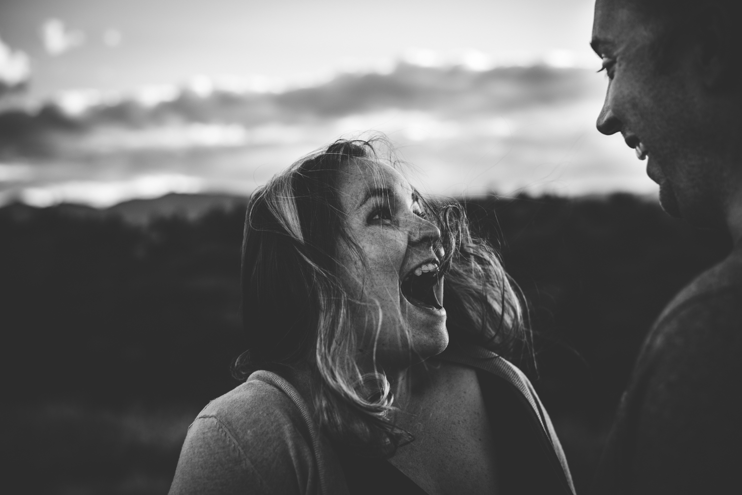Wife smiles happily at her husband during family session in Colorado Springs mountains.