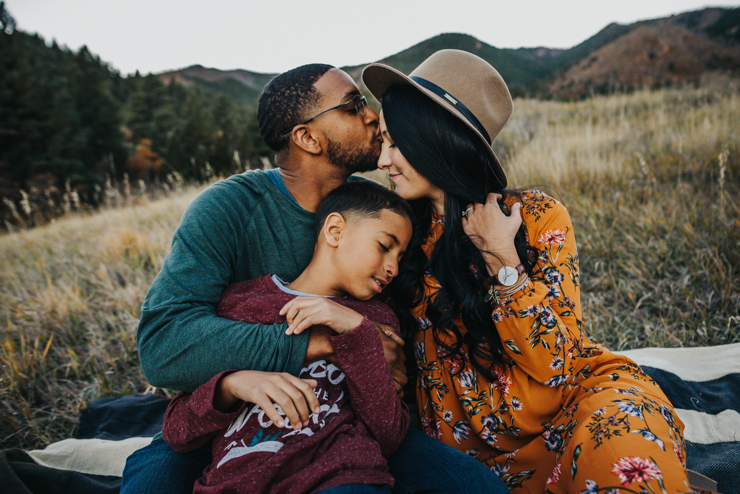 Sweet snuggles during fall family session in mountains of Colorado Springs.