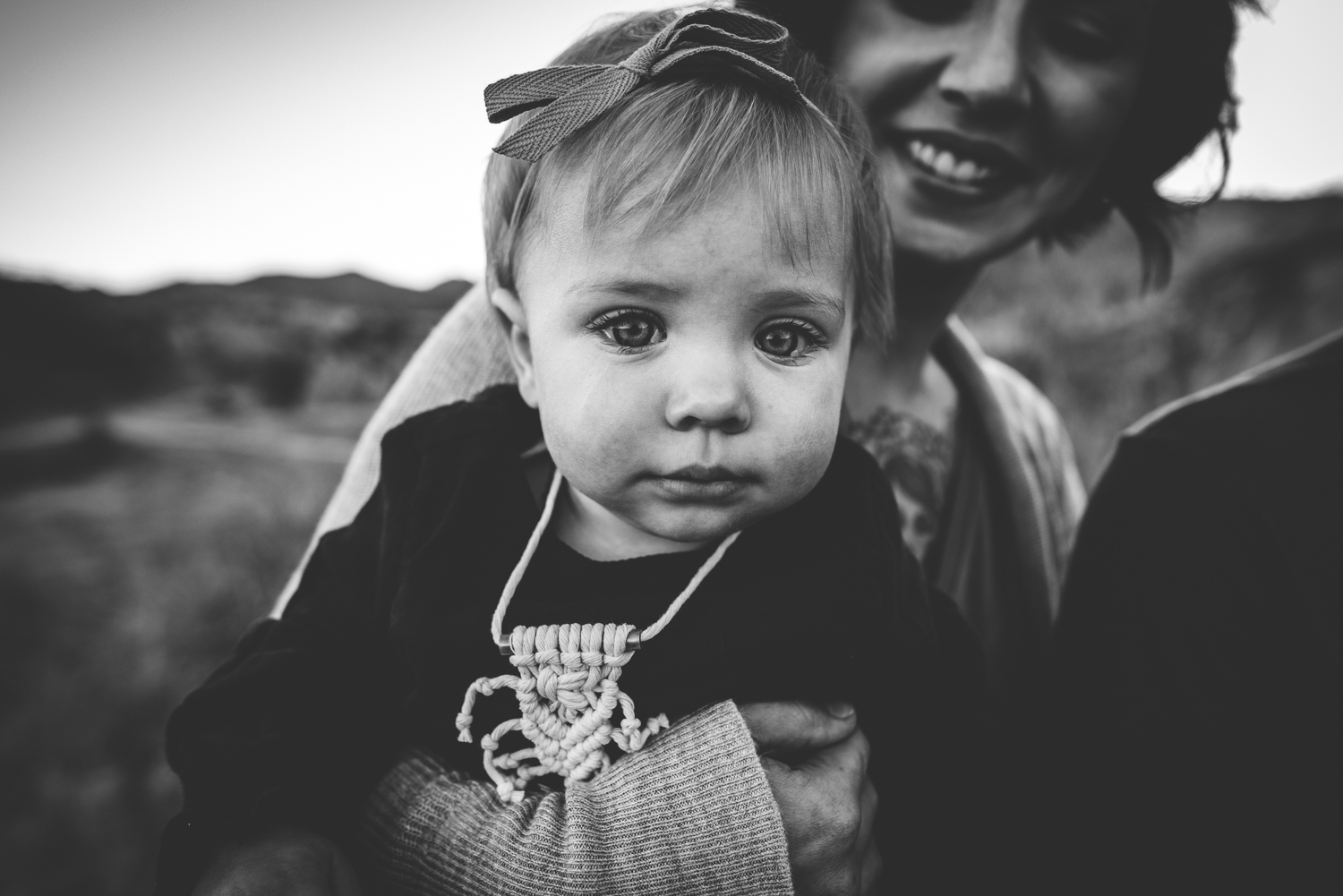 Daughter is snuggled during family session in Colorado Springs at Red Rock Open Space.