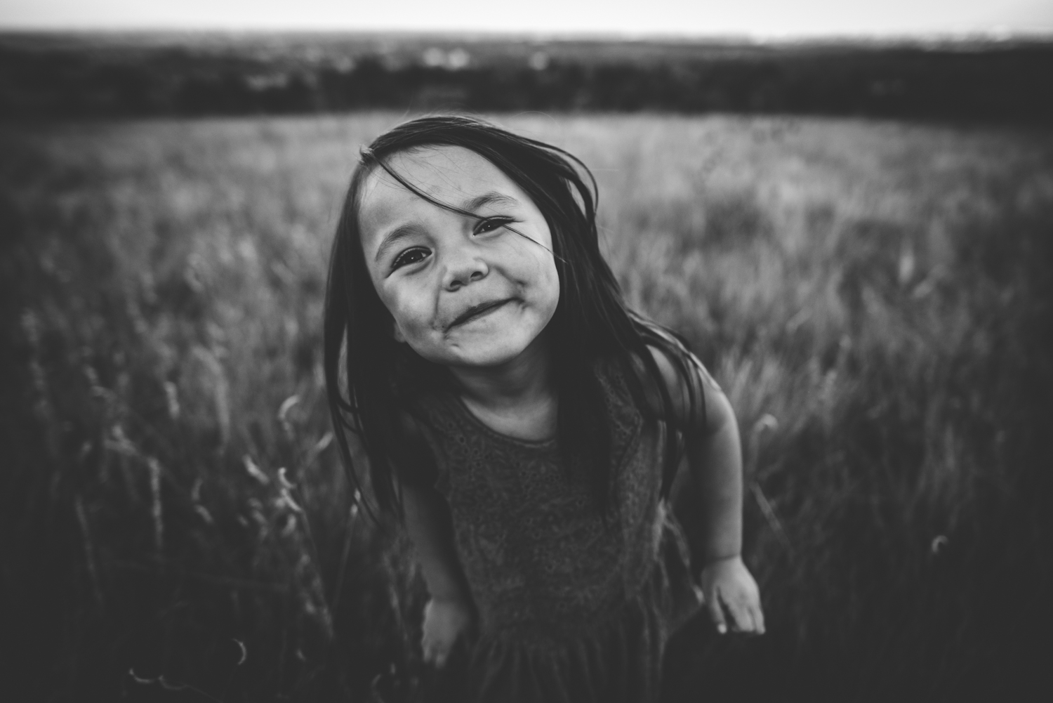 Little girl is happy during a photo session overlooking the city of Colorado Springs.