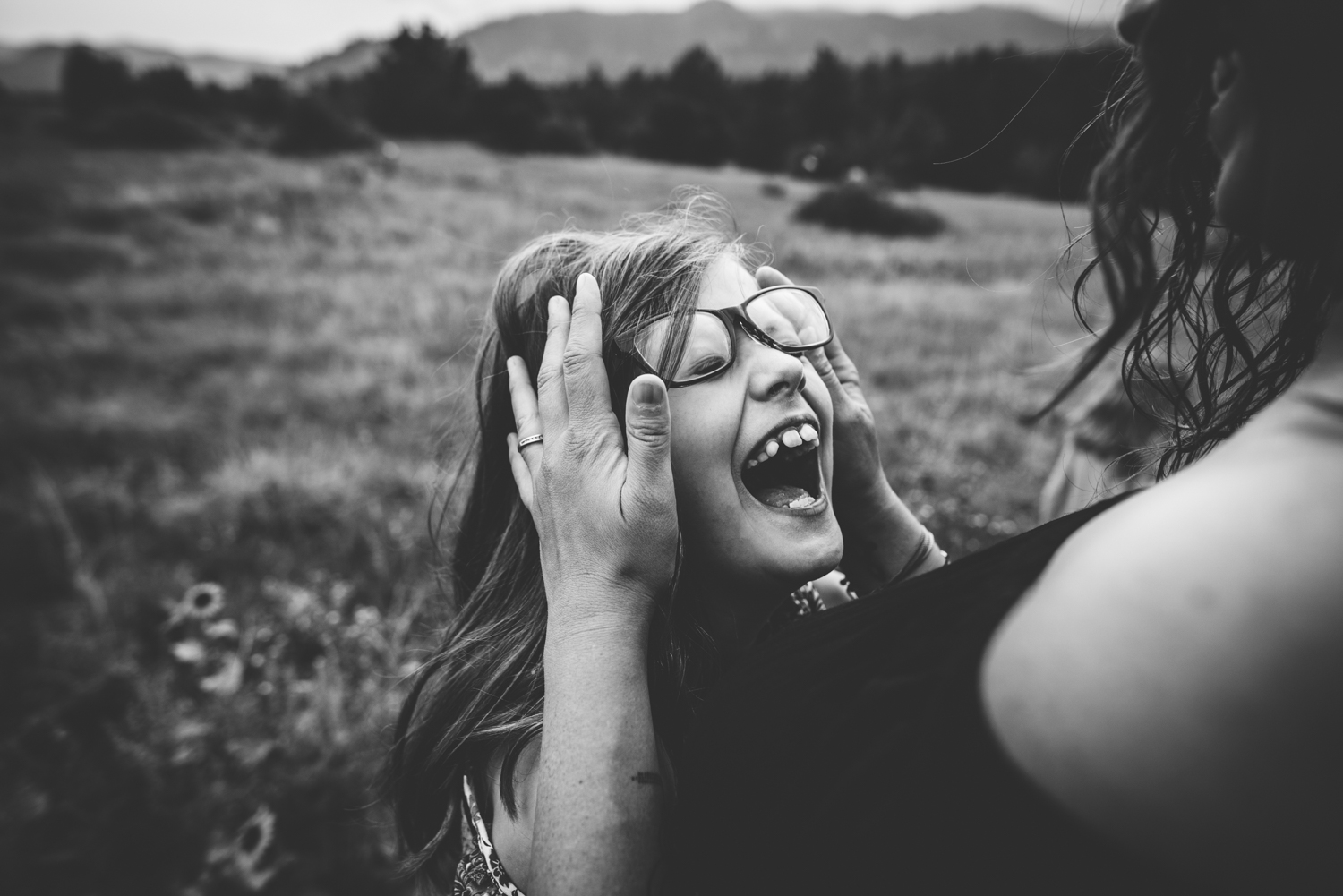 Happy little girl with her mom during their family session in the Colorado Springs mountains.