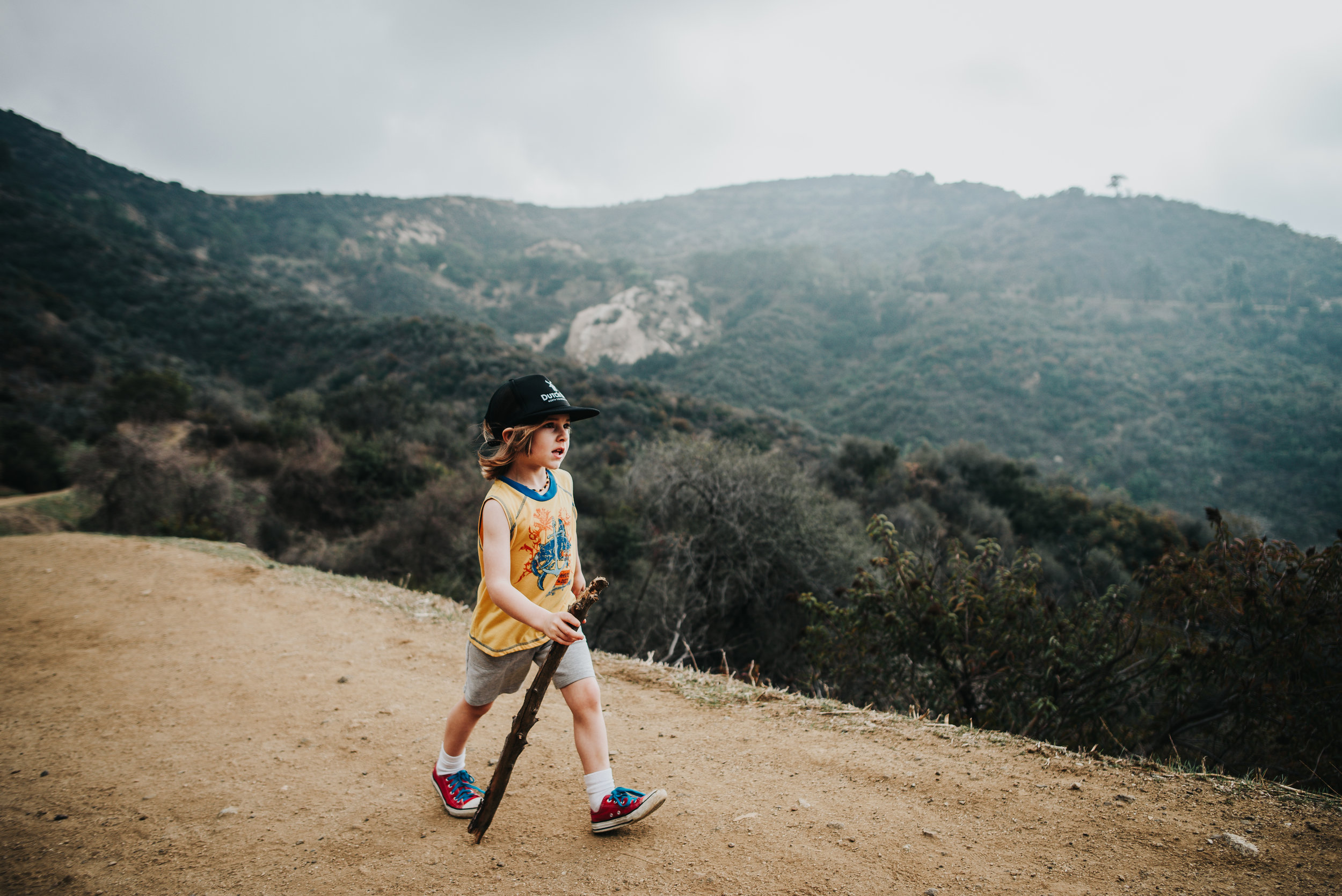Little boy hikes the trail up to visit the Hollywood sign in Hollywood, California.