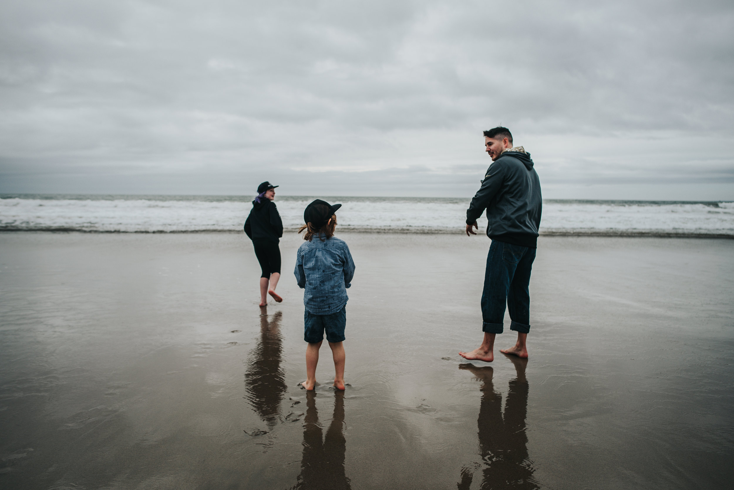 Family explores the California coast at Venice Beach near the Santa Monica Pier.