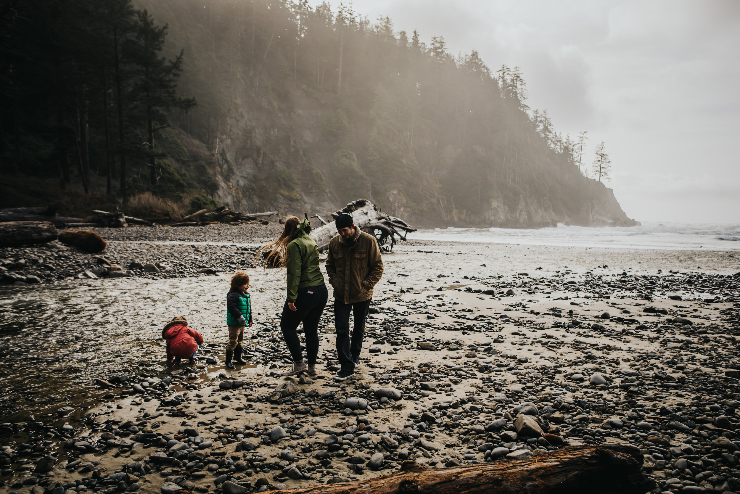 Family enjoys playing in the ocean with in Oregon.