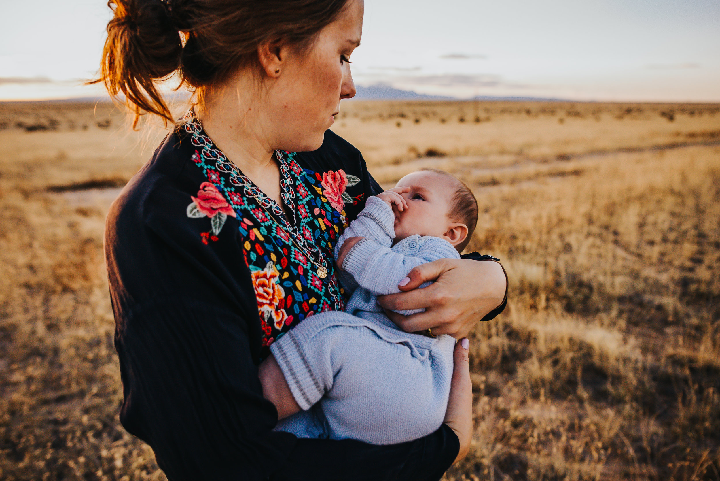 Mother and son cuddle during family photo session with Colorado Photographer