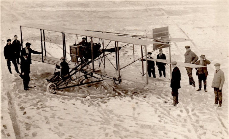 Ruth sits for the first time in her new Curtiss Model D biplane in Hammondsport, NY, 1915