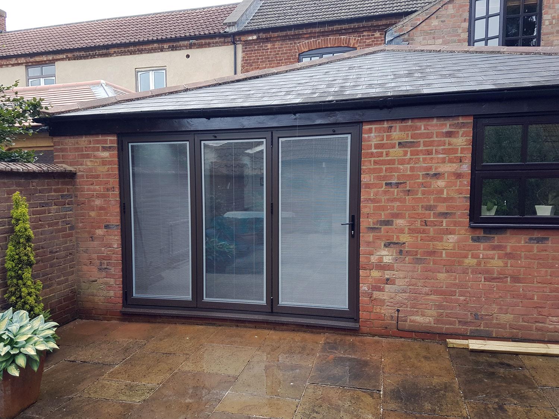 Bifold doors including integral blinds, Uppingham