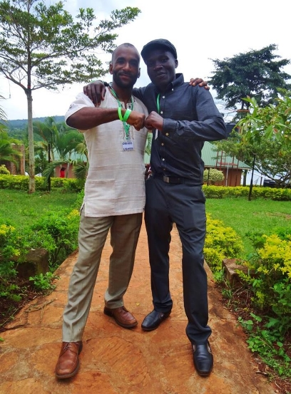 Omari with his sponsored student, Kafumufu Joseph, in Uganda.
