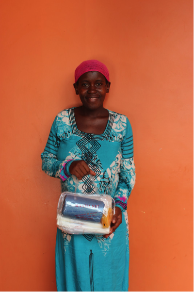 A S.O.U.L. mama with her mama kit, which includes supplies that support dignified and hygienic births