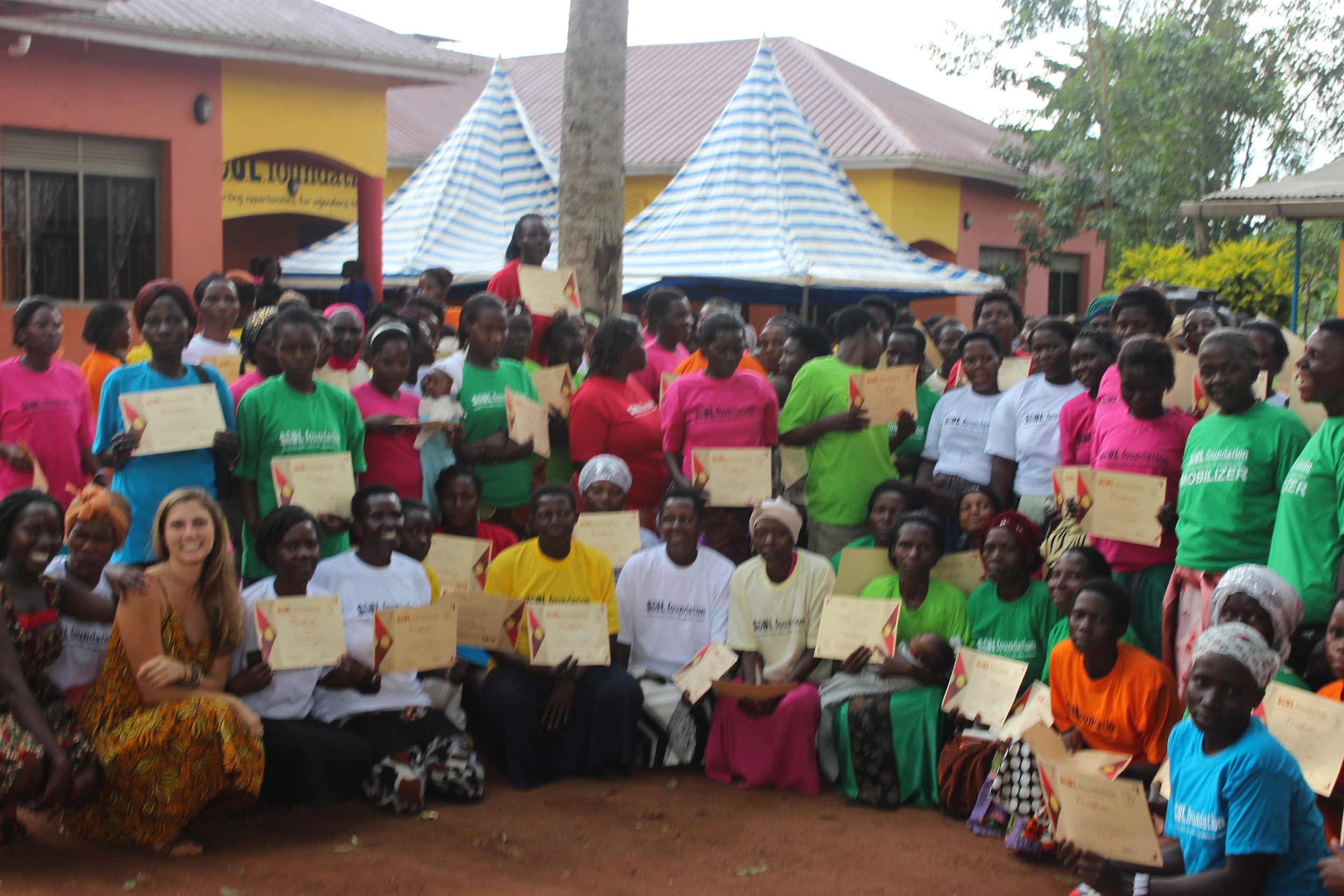 Course participants with their diplomas outside of the S.O.U.L. Foundation Community Center in Bujagali Falls, Jinja District, Uganda