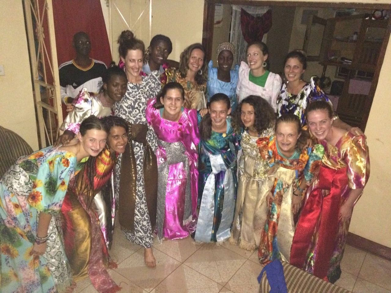 Students and S.O.U.L. staff wearing Gomesi, traditional women's wear, prior to celebrating their last night in Bujagali Falls. It was a night full of speeches, dancing, tears, and laughter!