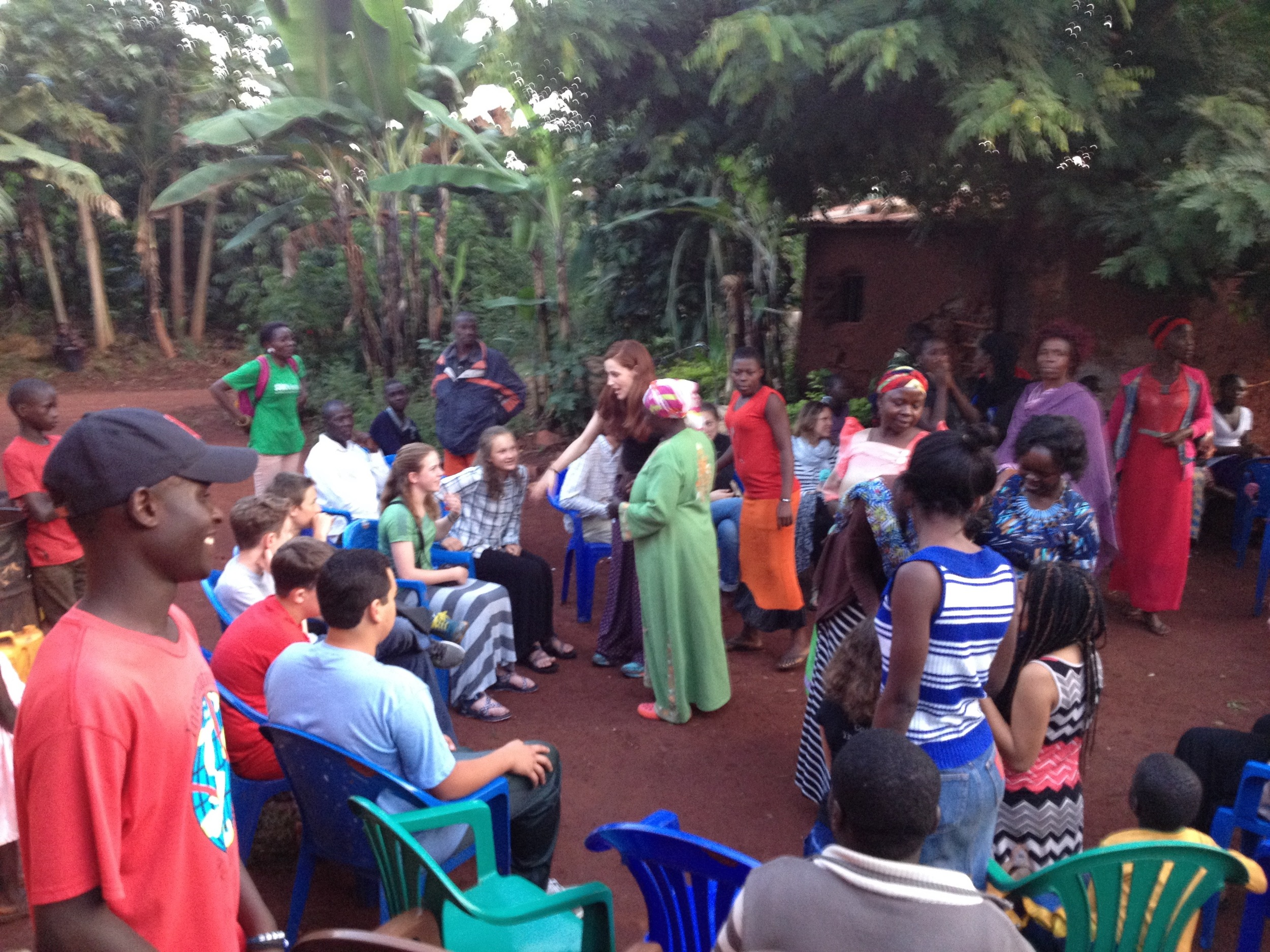 Students and chaperones settle in on one of their first evenings in Uganda