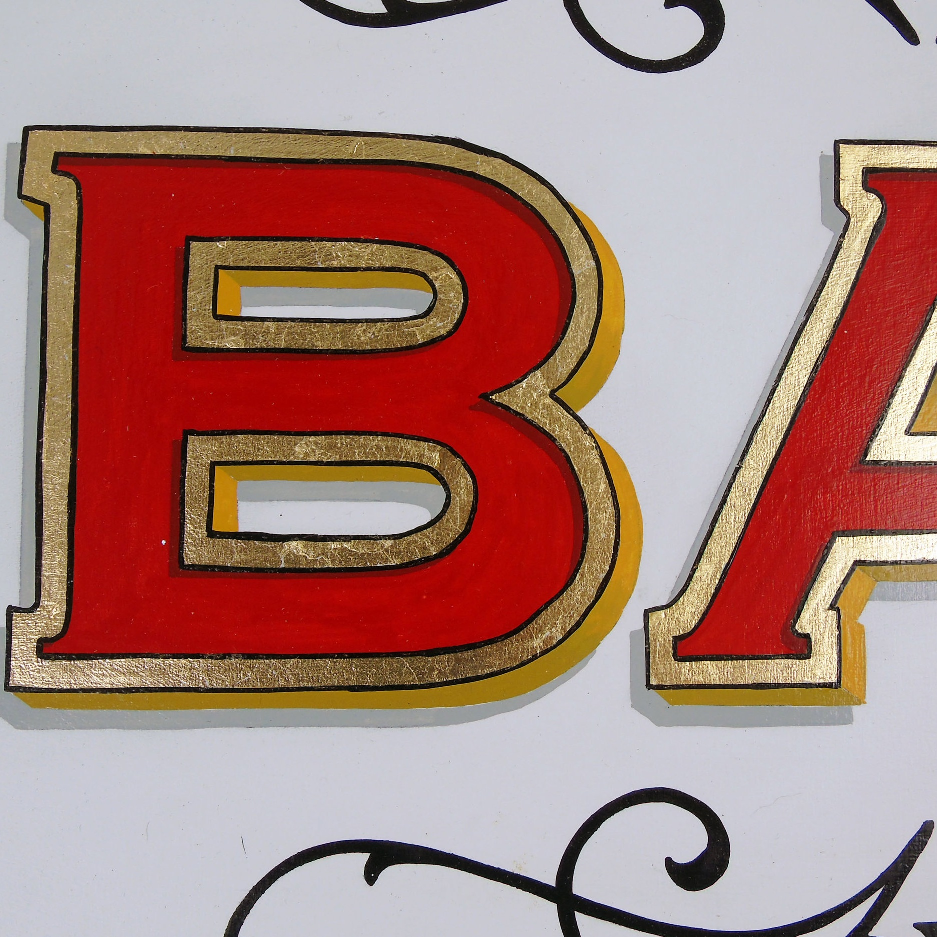 Red and gold leaf letter B