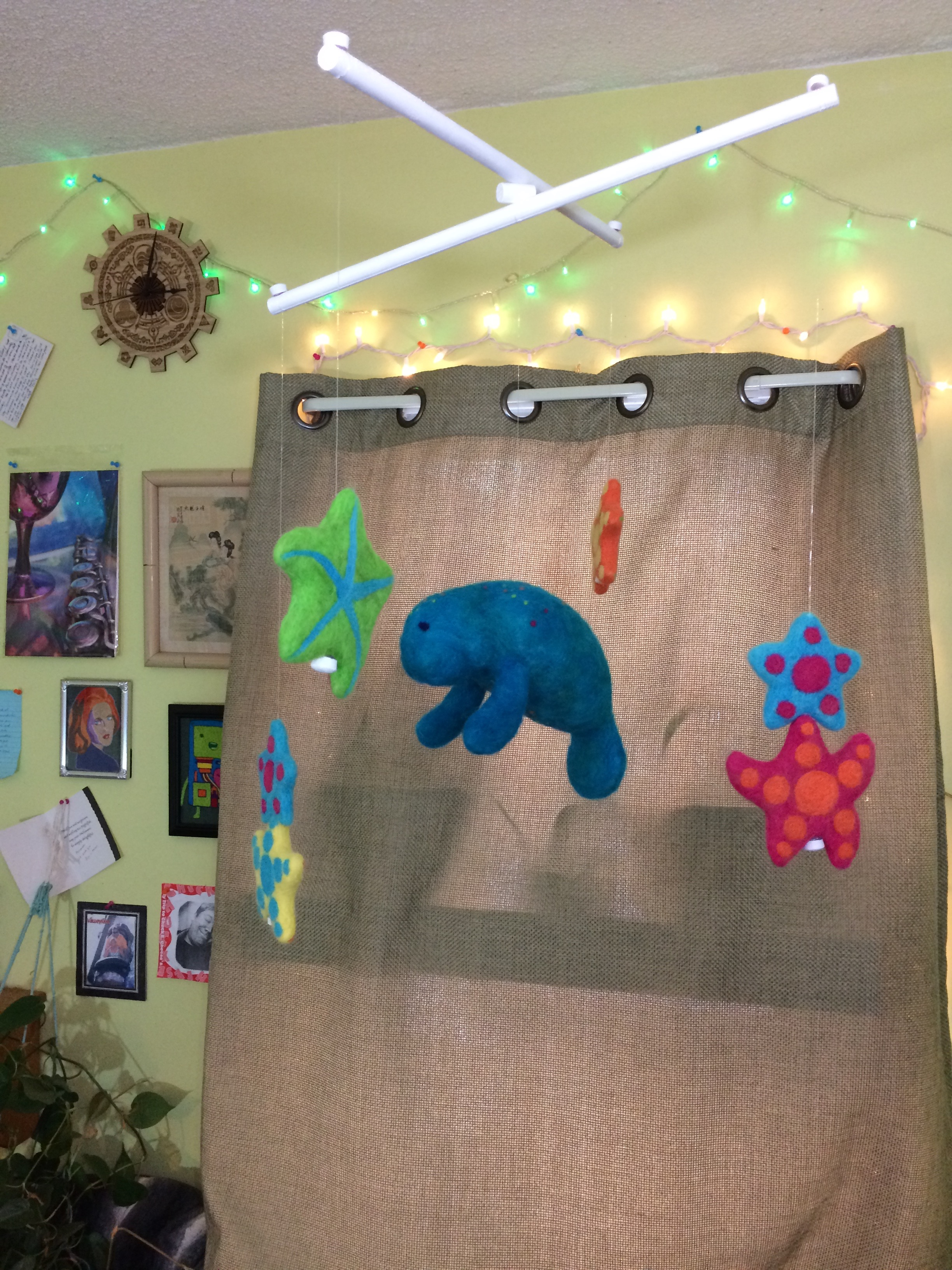 Crib Mobile made of needle-felted sea creatures: starfish and manatee.