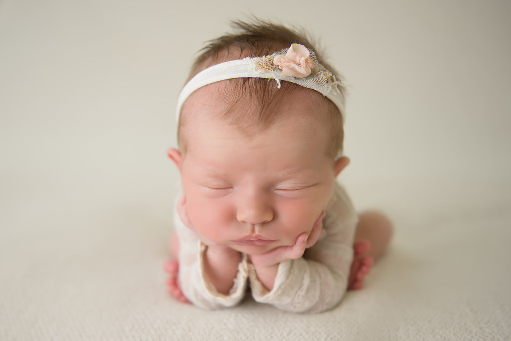 {This is a composite image - Baby is always supported at all times - Do not attempt newborn photography poses without being properly trained by a professional newborn photographer}