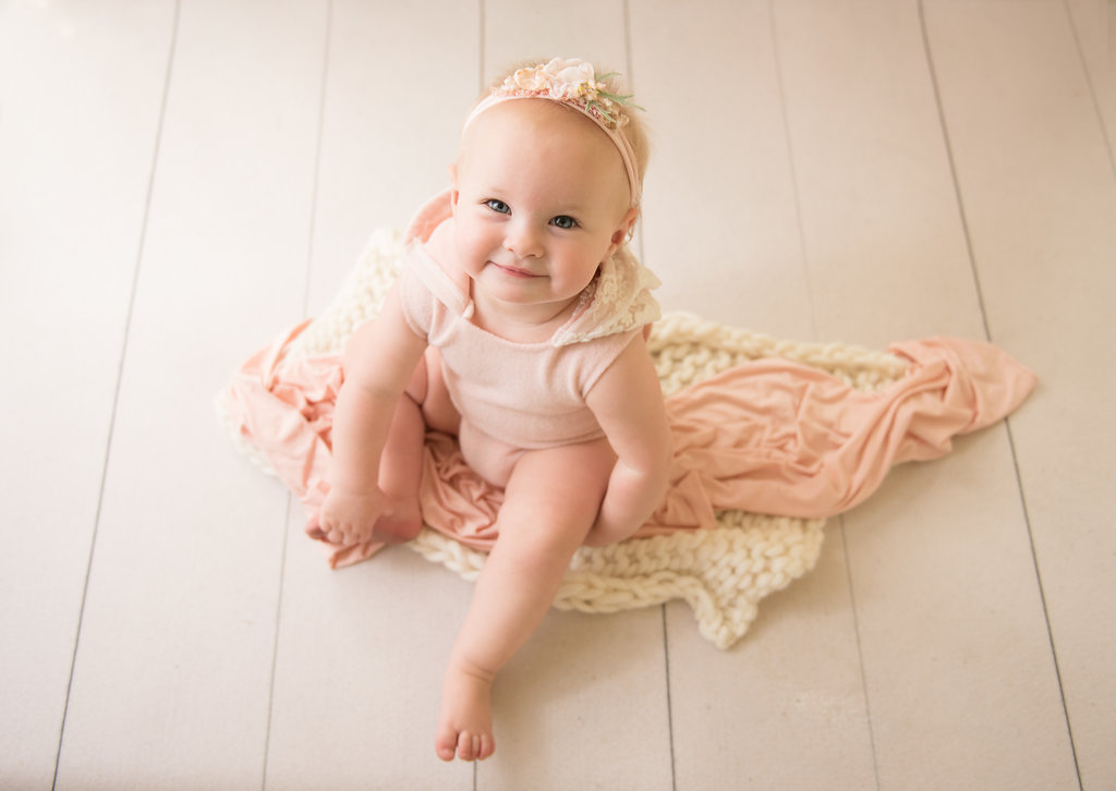 seattle newborn photographer seattle milestone photographer baby girl in pink one year session