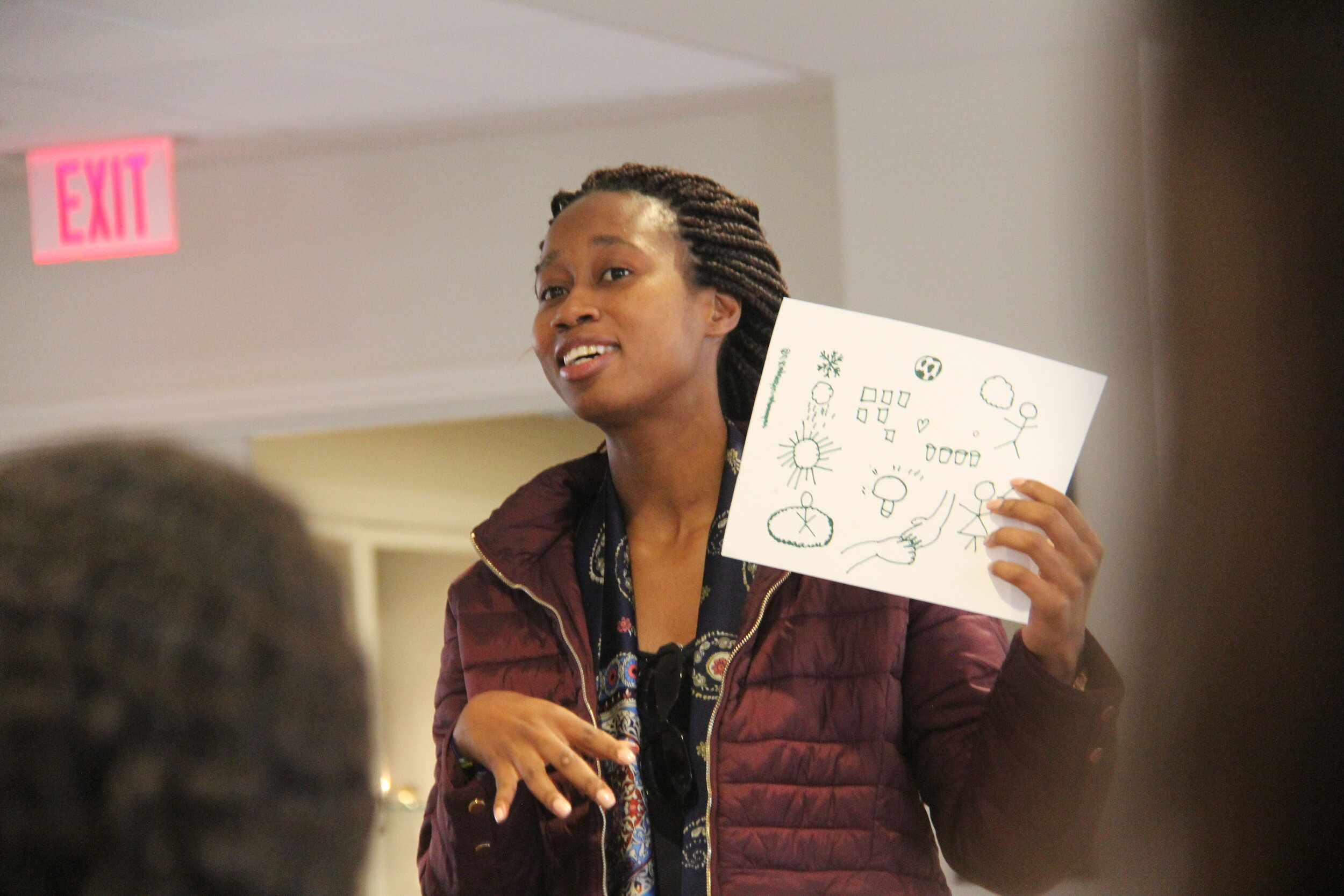 A delegate presenting during a quick brainstorming session at the summit.