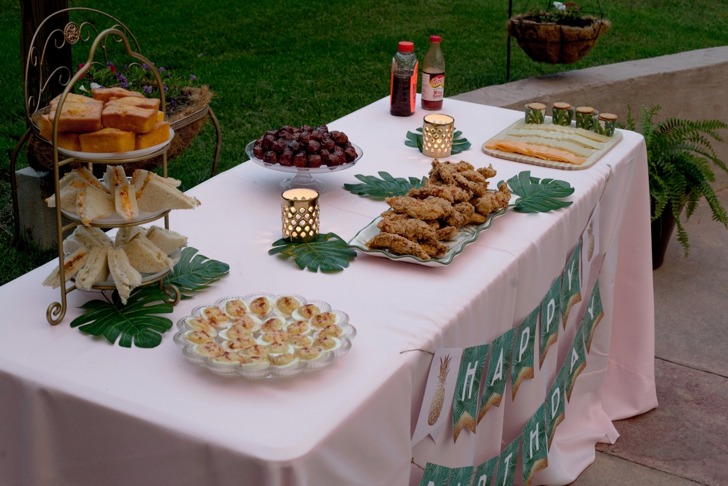 Not your traditional dinner party spread but it was far too hot for heavy food and keeping the prep/cook time to a minimum allowed me to enjoy my guests. Thanks to my awesome friends that helped in the kitchen! The banner on this table is actually from my birthday last year, but it is from  JazzHandsPaperCo  on Etsy.