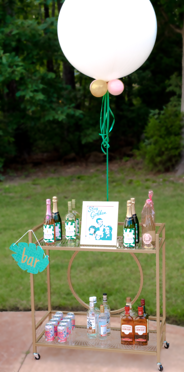 "Y'all know I couldn't have a party without my bar cart! The cart is from  Wayfair  and the ""bar"" sign from the Target Dollar Spot!"