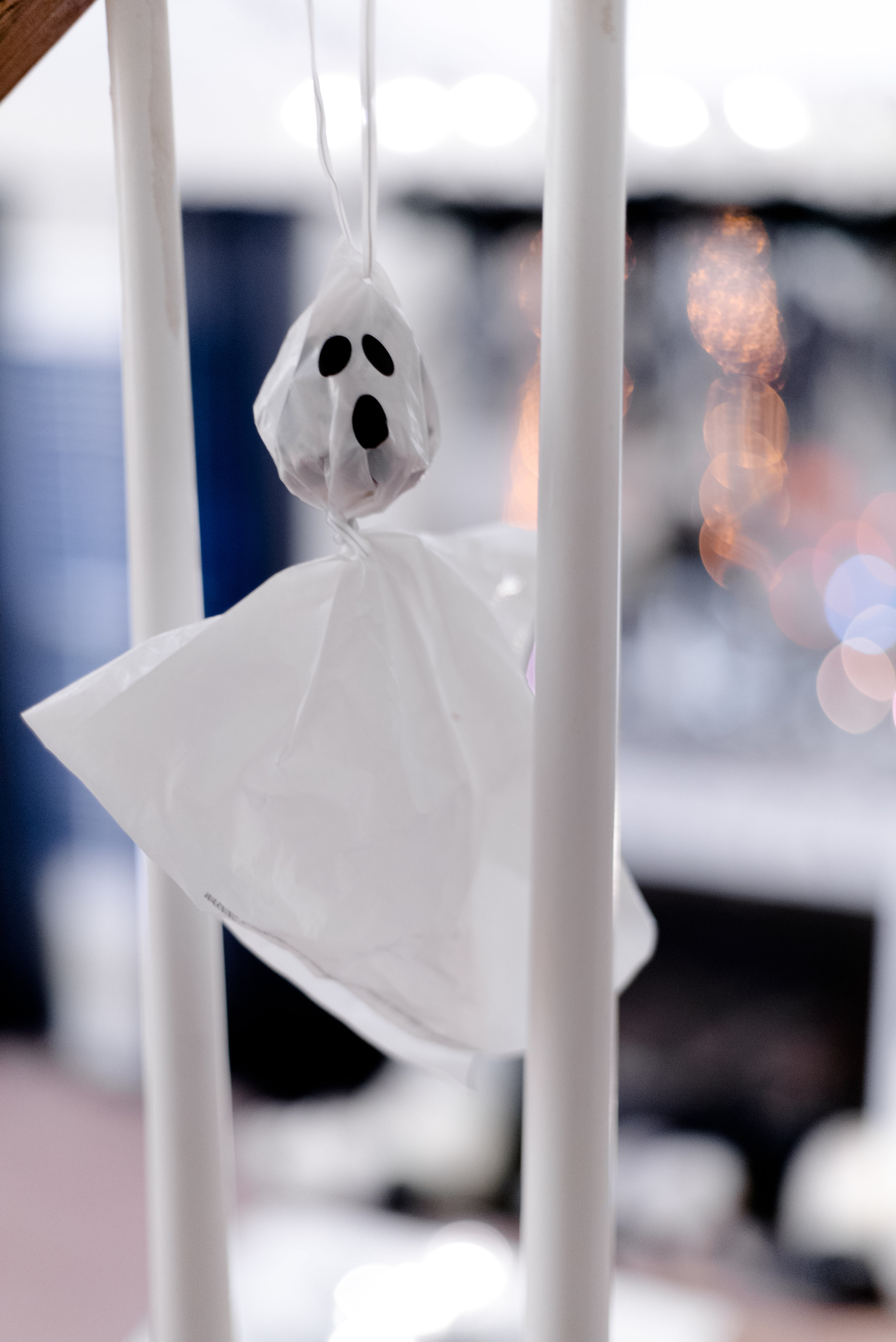 My dad and I made these ghosts when I was younger and I've held on to them. I hang them between the stair railings so the ghosts appear to be scurrying up the stairs.