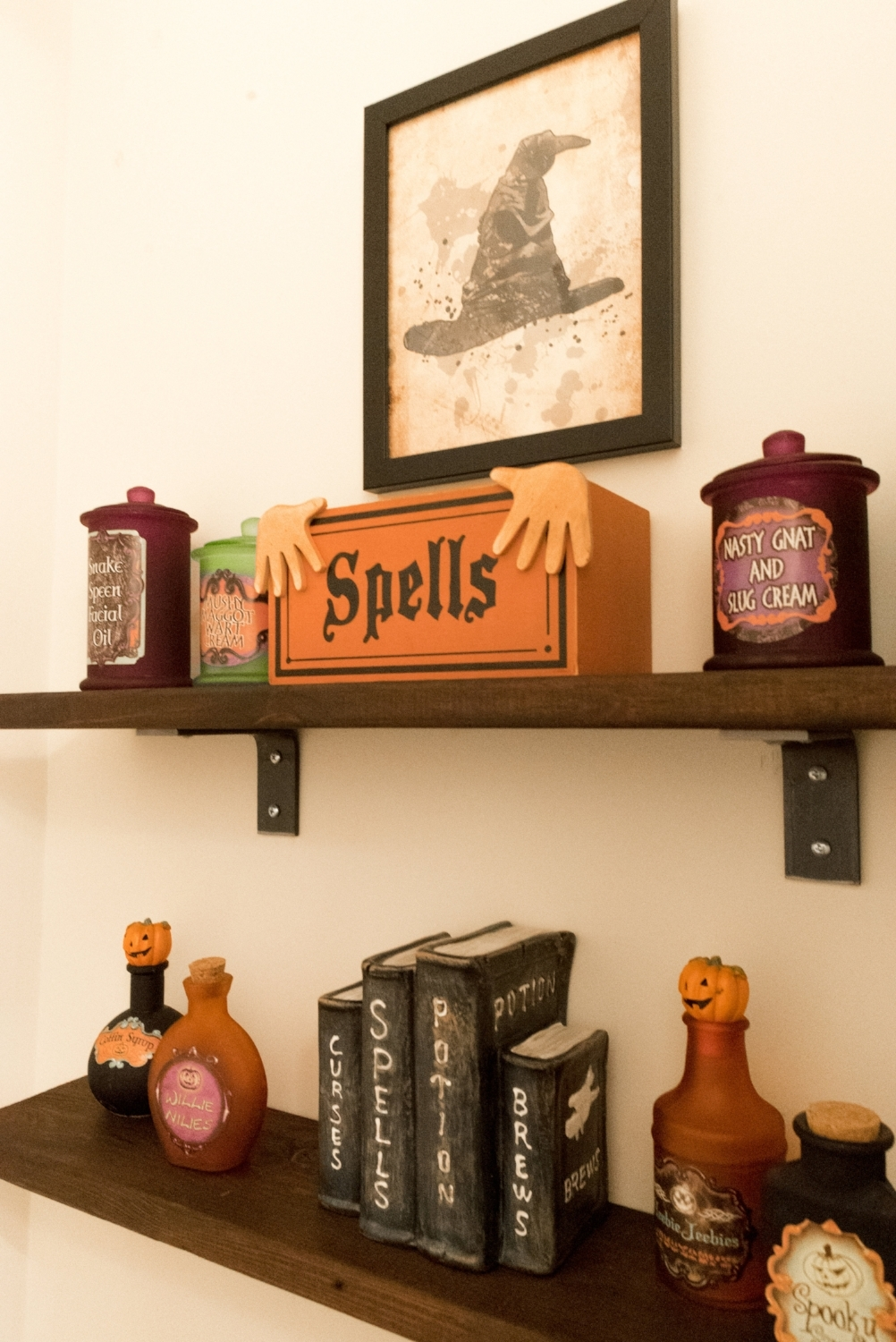 Etsy printables are such budget friendly options, like this Sorting Hat above our potions and spells shelves.